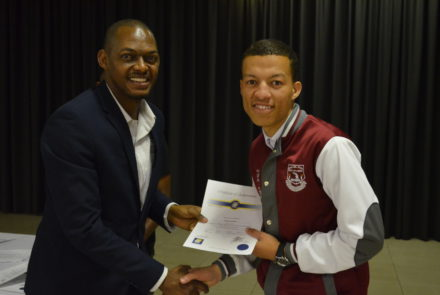 Solly Ledwaba from DOE handing over 'Go for Gold High Achiever Award' to Morgan in November 2016.